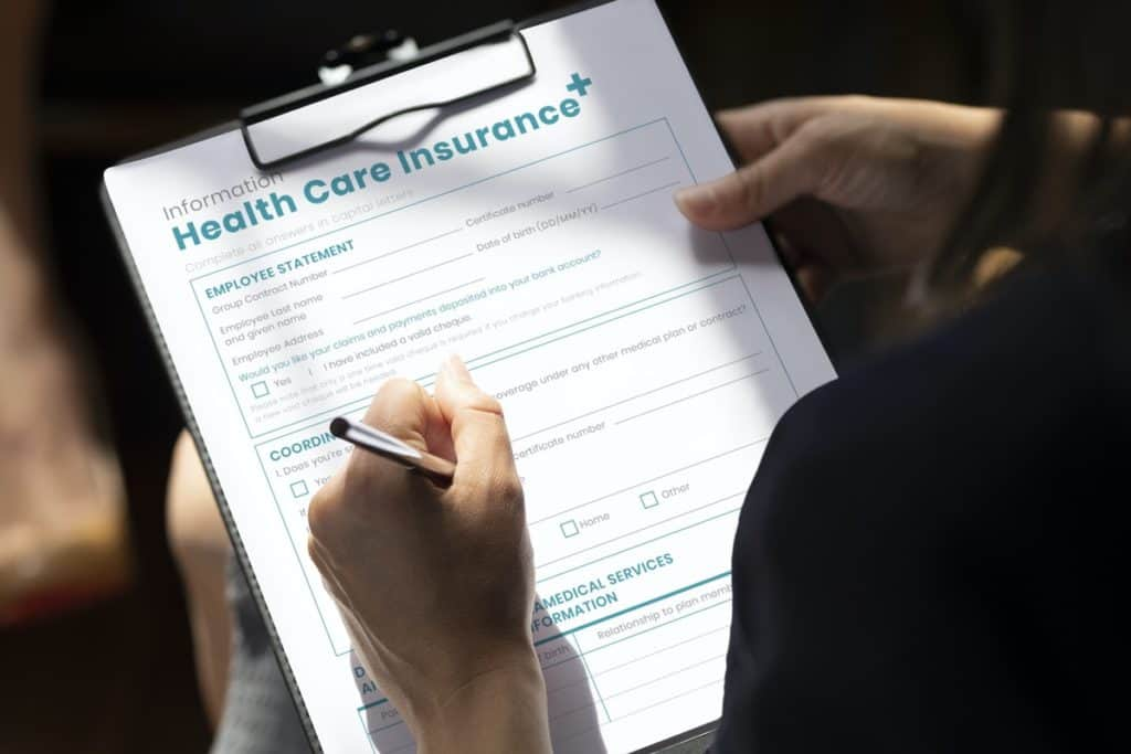 Woman filling out health care insurance form