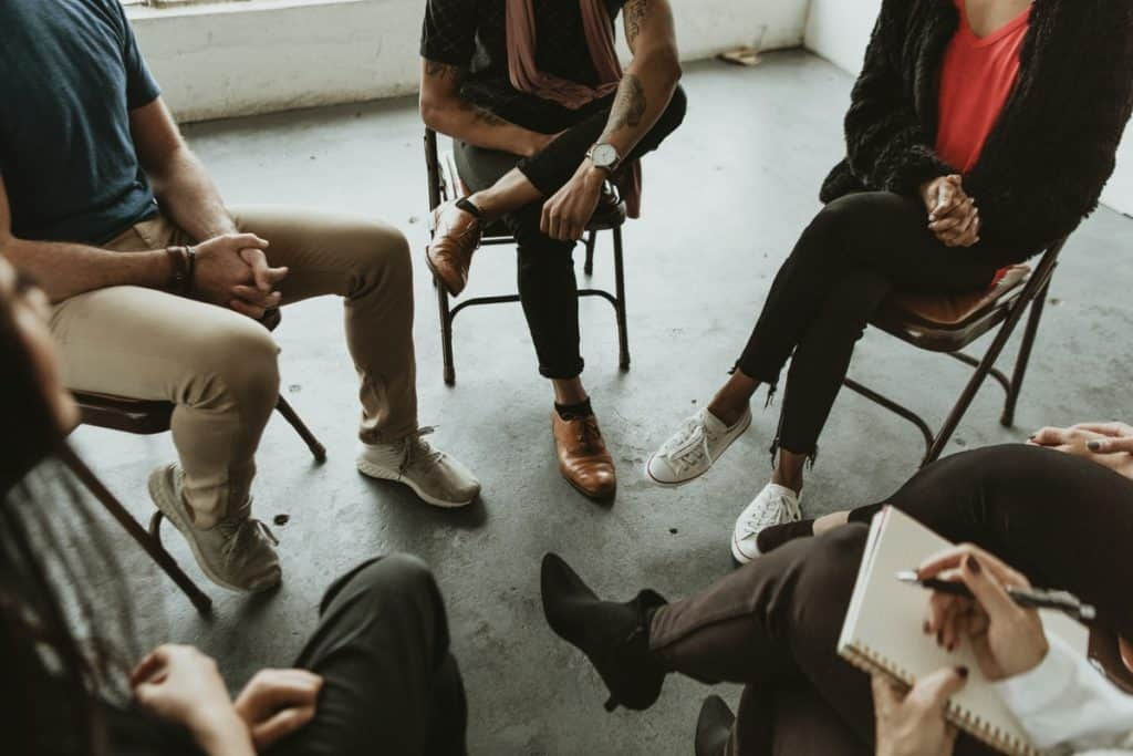 Diverse people in a supporting group session