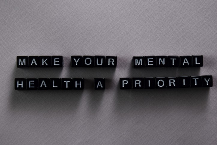 Make your mental health a priority on wooden blocks. Motivation and inspiration concept